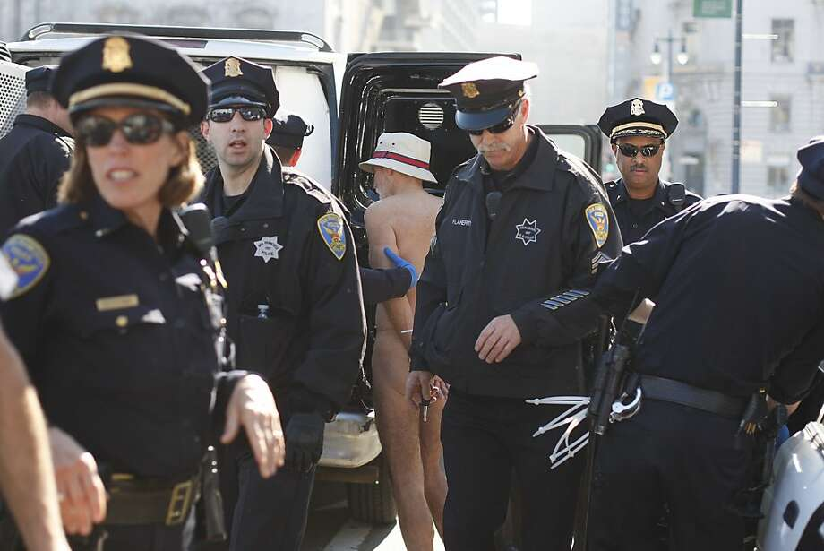 A protestor is taken away by San Francisco Police after disrobing in front of city hall on Friday, Feb. 1. Protesters were demonstrating the city's ban on nudity which goes into effect today. Photo: James Tensuan, The Chronicle