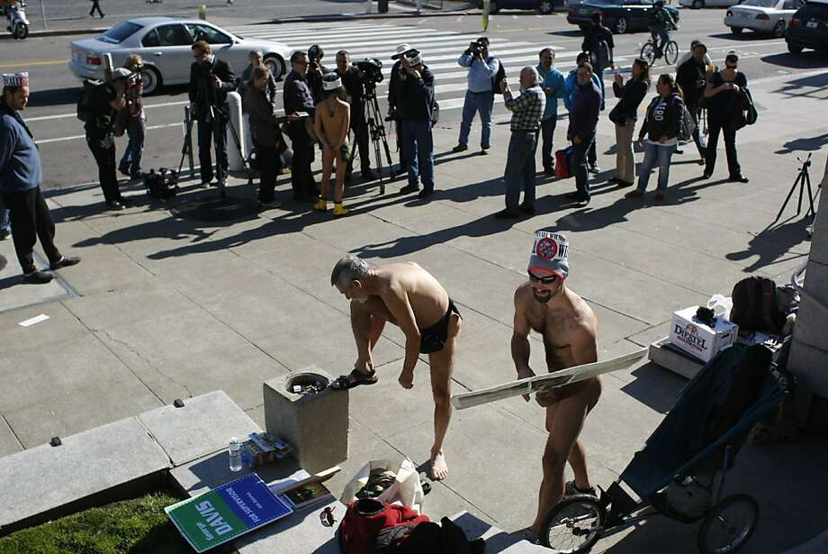 Nude demonstrators gather in front of city hall on Friday, Feb. 1. Protesters were demonstrating the city's ban on nudity which goes into effect today. Photo: James Tensuan, The Chronicle