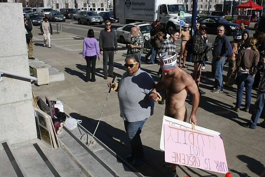 Nude protester Trey Allen helps Ernestine Patterson of San Francisco walk up the steps of City Hall. Allen was among four people cited for nudity. Photo: James Tensuan, The Chronicle