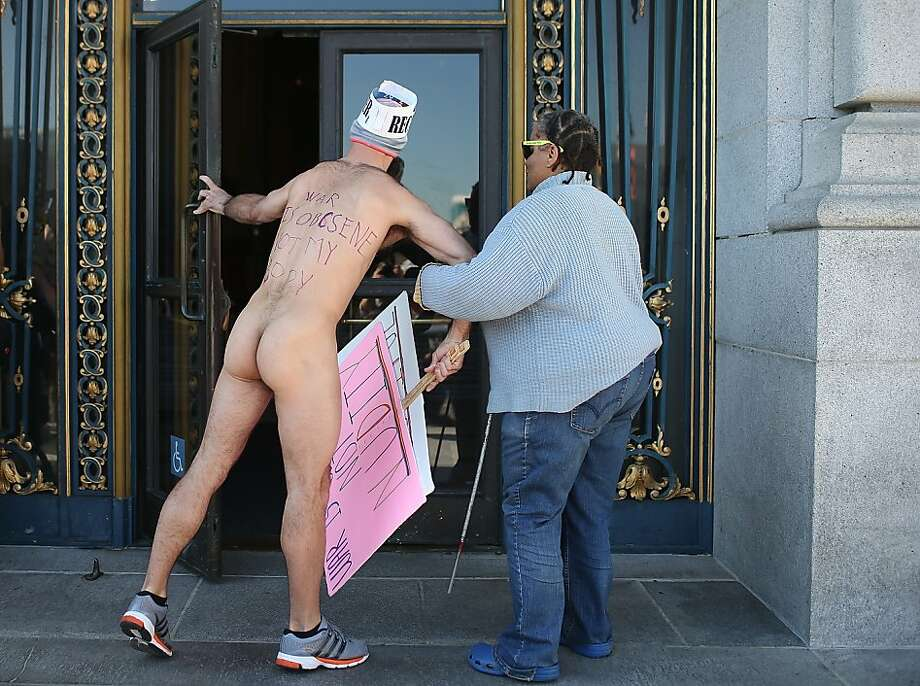Nude activist Trey Allen helps a blind woman through the front door at San Francisco City Hall as he protests San Francisco's new ban on nudity on February 1, 2013 in San Francisco, California. At least four nude activists were arrested as they protested San Francisco's new ban on nudity in public places. The measure proposed by Supervisor Scott Wiener is being challenged by activists who call the ordinance unfair because it grants exceptions for nudity at permitted public events. Photo: Justin Sullivan, Getty Images
