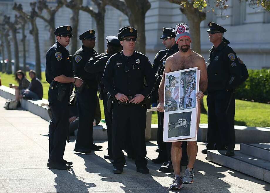 Nude activist Trey Allen stands nude in front of San Francisco police officers as  he protests San Francisco's new ban on nudity at San Francisco City Hall on February 1, 2013 in San Francisco, California. Photo: Justin Sullivan, Getty Images