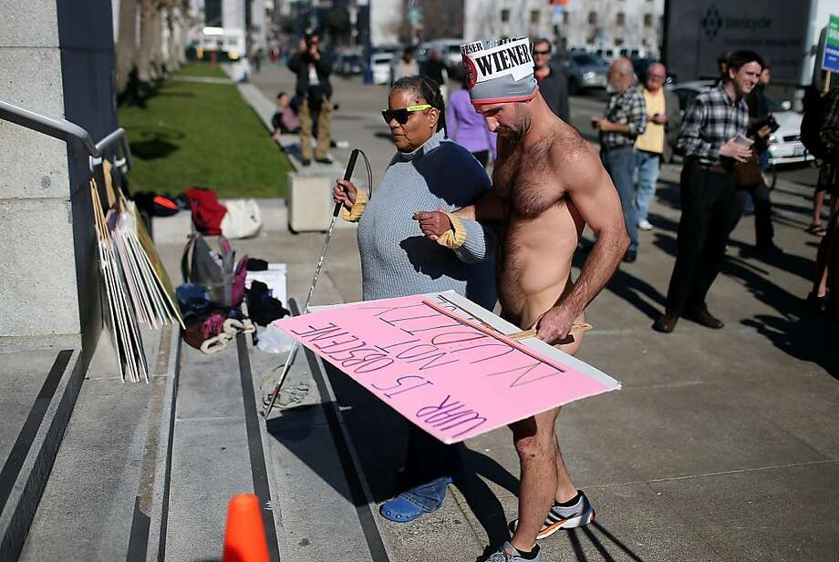 Nude activist Trey Allen helps a blind woman up stairs as he protests San Francisco's new ban on nudity at San Francisco City Hall. Photo: Justin Sullivan, Getty Images