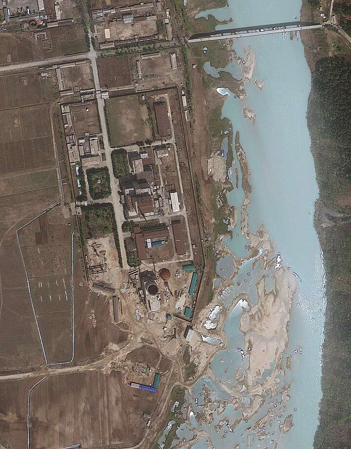 FILE - This April 30, 2012 file satellite image provided by GeoEye shows the area around the Yongbyon nuclear facility in Yongbyon, North Korea. As North Korea warns that it plans its third nuclear test since 2006, outside governments and analysts are trying to determine a crucial question: Just what will Pyongyang's scientists explode? The last two tests are believed to have been of plutonium devices, but the next logical step for Pyongyang's ambitious nuclear program could be to conduct a highly enriched uranium explosion. That would be a major accomplishment for North Korea — and a worrying development that would raise already high stakes for the United States and its allies. This GeoEye imagery was provided when the U.S.-Korea Institute at Johns Hopkins School of Advanced International Studies said May 16, 2012 it shows that North Korea has resumed building work of the containment building for the light-water reactor after months of inactivity at the site in Yongbyon. Photo: Uncredited, Associated Press