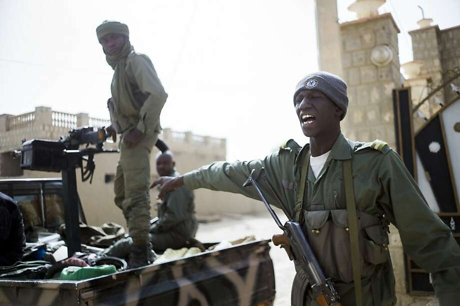 Malian soldiers patrol the streets in Timbuktu as French-led troops secure the last Islamist stronghold in the north. Photo: Fred Dufour, AFP/Getty Images