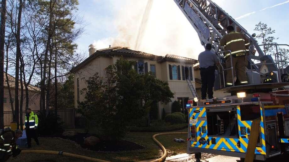 The stubborn blaze kept firefighters busy. Photo: Scott Engle / MC Reporter