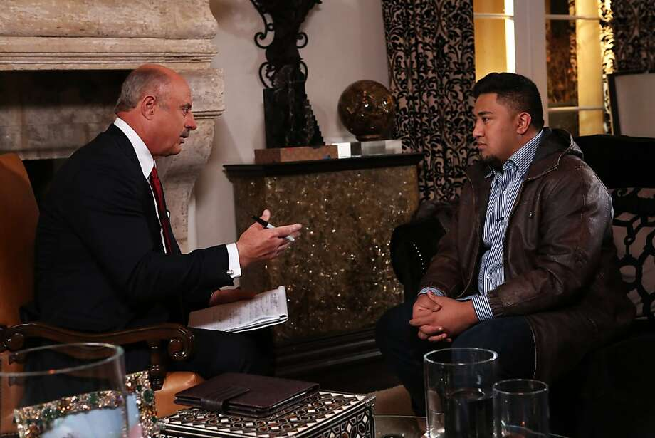 """Phil McGraw, host of the """"Dr. Phil Show,"""" talks with Ronaiah Tuiasosopo about his ruse. Photo: Associated Press"""