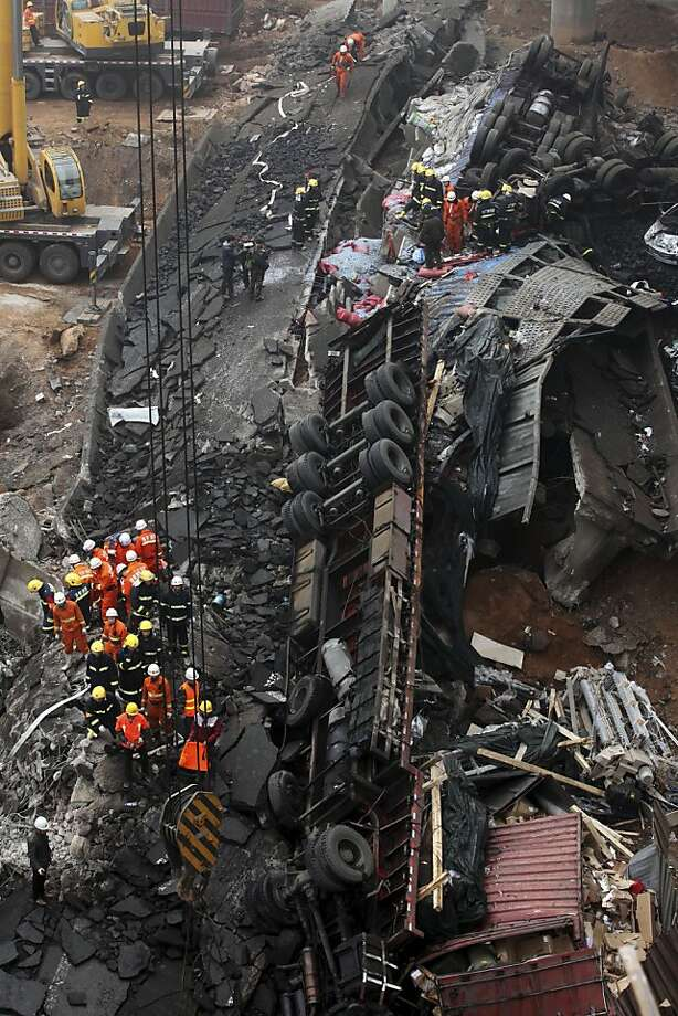 Rescuers work at the accident site where an expressway bridge partially collapsed due to a truck explosion in Mianchi County, Sanmenxia, central China's Henan Province, Thursday, Feb. 1, 2013. A truckload of fireworks intended for Lunar New Year celebrations went off Friday in a massive, deadly explosion that destroyed part of an elevated highway in central China, sending vehicles plummeting 30 meters (about 100 feet) to the ground. Photo: Associated Press