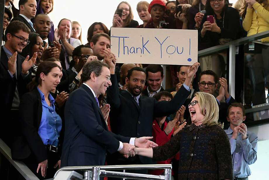 """U.S. Secretary of State Hillary Clinton (R) shakes hands with Deputy Secretary of State for Management and Resources Tomas Nides after delivering her farewell address to the staff in the C Street lobby of the State Department on February 1, 2013 in Washington, DC. With a strong record in exerting what she called """"soft power,"""" Clinton is leaving the State Department and the Obama Administration after travling 956,733 miles and visiting some 112 countries.  Photo: Chip Somodevilla, Getty Images"""