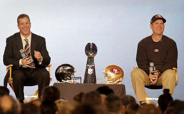 Brothers John (left) and Jim Harbaugh shared a laugh when recalling their childhood. The Harbaugh brothers, Jim and John, met the media in New Orleans, La. to talk about their teams and the upcoming Super Bowl Friday February 1, 2013. Photo: Brant Ward, The Chronicle