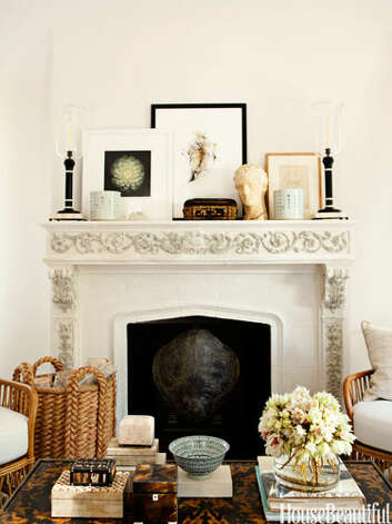 "Display a Favorite CollectionIn the living room of a West Hollywood house, the mantel and coffee table display designer Mark D. Sikes's passions: boxes, books, and art from China and Paris flea markets. ""When I see an empty table, I shudder a bit,"" he says. ""There are times when minimalism can be the right thing. A table with one vase of flowers and one little accessory is thoughtful, while a gorgeous table with copies of Us and People magazines just looks neglectful."" Photo: Amy Neunsinger"