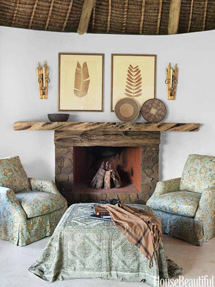 "Put a Throw On ItIn the master suite seating area in a Kenya home, designer Suzanne Kasler arranged armchairs in a vintage floral around the fireplace and an ottoman draped with an Indian throw, which gave the space ""an English feeling."" It's the perfect balance of cultures. ""I was definitely inspired by that weaving of African and British traditions and aesthetics — marrying a sense of place with familiar comforts and luxuries,"" she says. Photo: Thibault Jeanson"