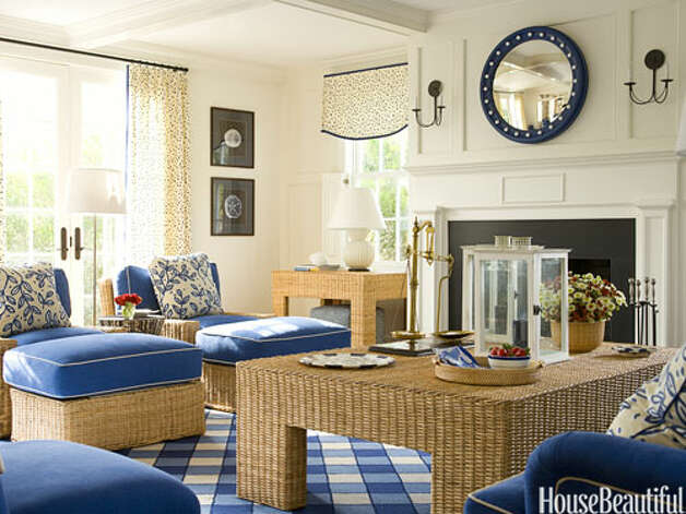 "Light a LanternThe living room in a Nantucket cottage designed by T. Keller Donovan has a fresh, contemporary look. An oversize lantern — a favorite design accessory — stays accessible on the wicker coffee table. ""It's an easy way to have a party — you just light the candle in there and whoopee! it's a party. My mother was forever asking, 'Where are the candles?' It was always such a process."" Photo: John Gould Bessler"