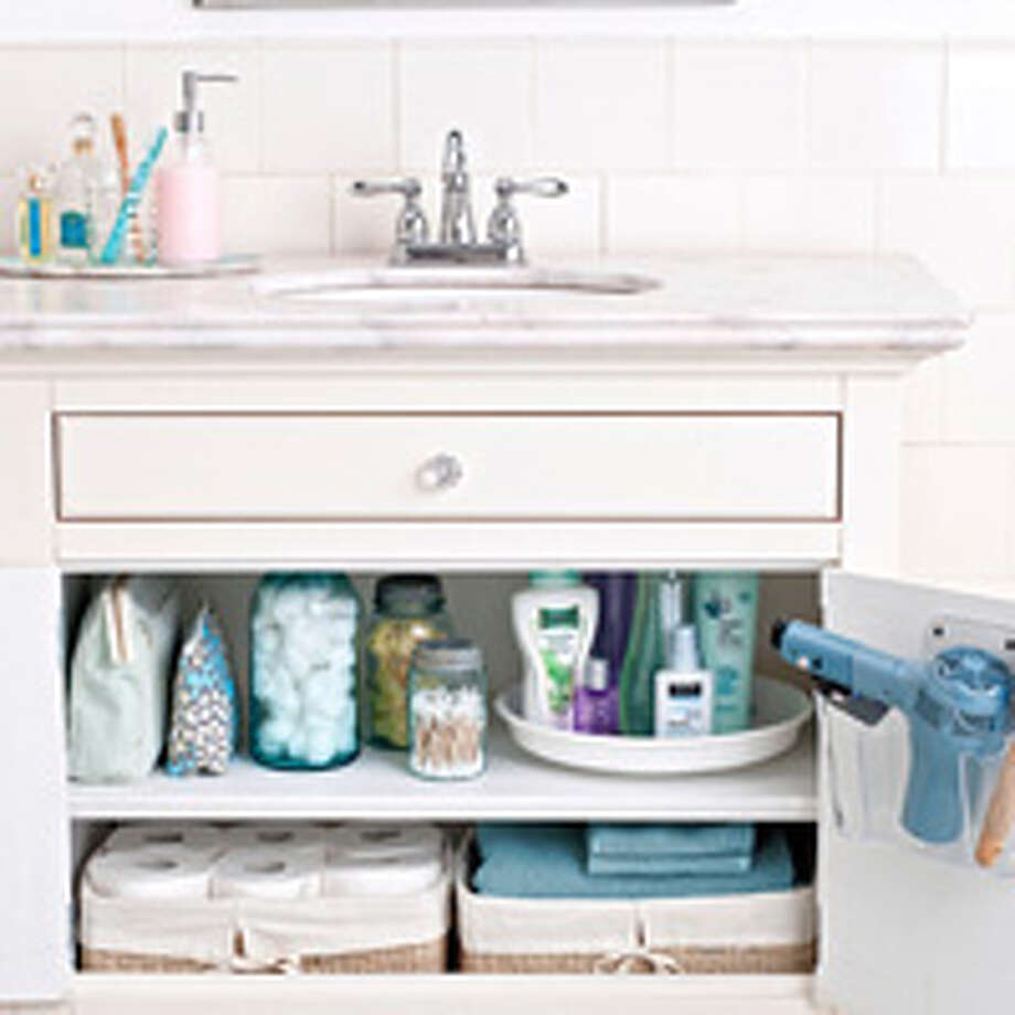 1. Brighten the Bathroom First, flush. Next, grab some bleach. Pour a cup into the bowl; brush around the sides and under the rim. Next, fill a spray bottle with equal parts water and white vinegar. Spritz onto paper towels or a microfiber cloth, and hone in on those telltale soap drips and toothpaste spatters on faucets, mirrors, countertops, and in the sink — a definite dirty-bathroom giveaway. Next, shake out your rug or bath mat to fluff it up so it looks recently vacuumed. Now, flush the bleach that's been sitting in the bowl.Reprinted with Permission of Hearst Communications, Inc. Originally Published: 16 Ways to Fake a Clean Home — Fast Photo: Andrew McCaul