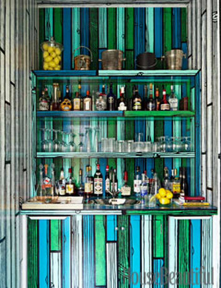 "Art BarThe homeowner of a house in East Hampton, New York, asked artist Richard Woods to work his fun, faux-bois magic on the bar, transforming a closet-like space into a vivid focal point. ""It's artistic, but very much a bar,"" designer Mica Ertegun says. ""It's whimsical, fun, unexpected — and one-of-a-kind."" Photo: Alec Hemer"