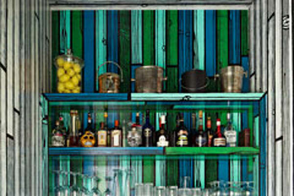 """Art Bar    The homeowner of a house in East Hampton, New York, asked artist Richard Woods to work his fun, faux-bois magic on the bar, transforming a closet-like space into a vivid focal point. """"It's artistic, but very much a bar,"""" designer Mica Ertegun says. """"It's whimsical, fun, unexpected — and one-of-a-kind."""""""