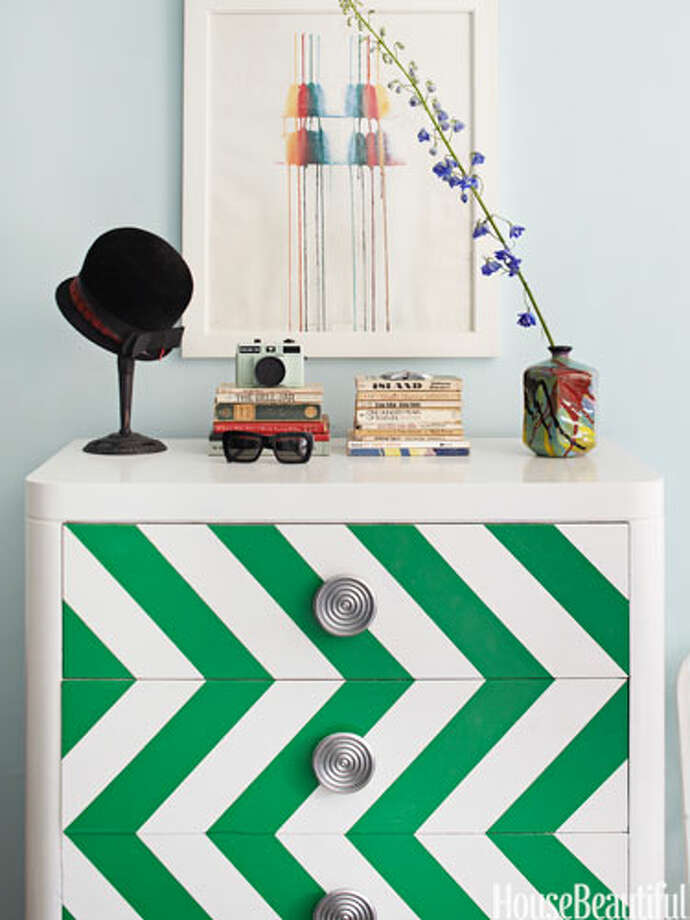 "Chevron ChestDesigner Nick Olsen amped up a Brooklyn studio apartment — just 295 square feet — by painting a flea-market chest in shiny white Rust-Oleum, with an emerald green chevron pattern. ""My motto is, 'Don't be afraid to paint,'"" he says. Photo: Bjorn Wallander / Copyright: Bjorn Wallander"