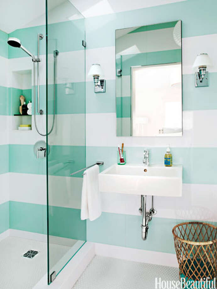 "StripesDesigner Angela Free installed tiles to form wide, horizontal stripes in a 37-square-foot guest bathroom in a San Francisco, California house. ""Stripes are a nice, graphic design element that can bring movement and pattern to a room, but not in a busy way,"" she says. By wrapping the pattern around the space, she opened it up and created ""flow, a borderless space."" Photo: James Carrière"