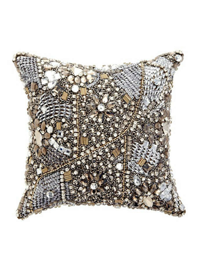 Jeweled PillowAn instant, dazzling way to dress up your sofa. Donna Karan Collection, Modern Classics Layered Jewel decorative pillow in Truffle. $188. bloomingdales.com. Photo: Studio D / Hearst Communications Inc., 2012