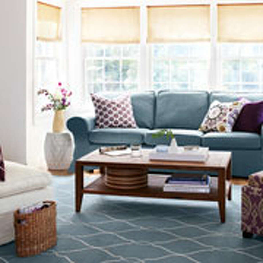 Living Room Rules: Keep the space guest-ready with these genius ideas  1. Dare to Be Spare With too much furniture, even the most spacious living room can look like an episode of Hoarders. Ease congestion by sticking to the basics — a sofa, a bookshelf, a comfy chair, an end table, and a coffee table—and arrange so there's clear, unimpeded traffic flow. — Meryl Starr, owner of Let's Get Organized 2. Prune the Pileup Be ruthless: Save only the last two issues of magazines. Tear out articles and keep in a binder you'll refer to later. — Justin Klonsky, Organizational expert for OCD Experience (Organize and Create Discipline) 3. Keep it Clean A stay-neat stat to memorize: The top of the coffee table should be 75% clear (yes, seriously). Styles with drawers or shelves below the surface will get you there fast. — Stephanie Hanes, prop stylist 4. Easy Come, Easy Go Corral smaller items — vases, candles — on a handled tray that's a cinch to relocate in a company's-coming pinch. — Justin Klonsky 5. Control Remotes Got multiples? Group them all together in a lidded box or a chic decorative bowl. — Stephanie Hanes 6. Pare Down Pillows A trio in complementary colors and patterns — one a solid — is your best bet for most sofas (a mega-couch can handle five, two of them solids). — Melissa Picheny, founder of declutter+design 7. Double Up Maximize storage and get extra seating with a hide-stuff-inside ottoman. — Alejandra Costello, professional organizer 8. Floor Show Having too many area rugs can...  Photo: Dana Gallagher