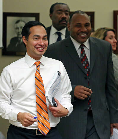 Mayor Julian Castro leads execuatives back into the room after Doyle Beneby is offered a new contract  during a board meeting at the CPS headquarters in San Antonio on February 1, 2013. Photo: Tom Reel, San Antonio Express-News / ©2012 San Antono Express-News
