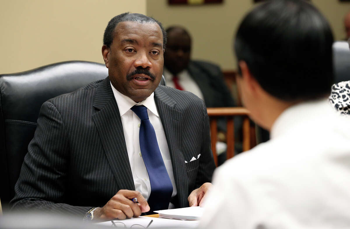 Doyle Beneby thanks Mayor Julian Castro after he is offered a new contract during a board meeting at the CPS headquarters in San Antonio on February 1, 2013.