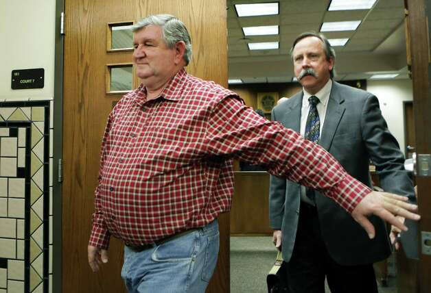 John DeLoach, left, former head of Bexar Towing, walks with his lawyer Carleton Spears in Municipal Court as DeLoach receives his sentencing for over-charging towing fees. Friday, Feb. 1, 2013 Photo: Bob Owen, San Antonio Express-News / © 2012 San Antonio Express-News