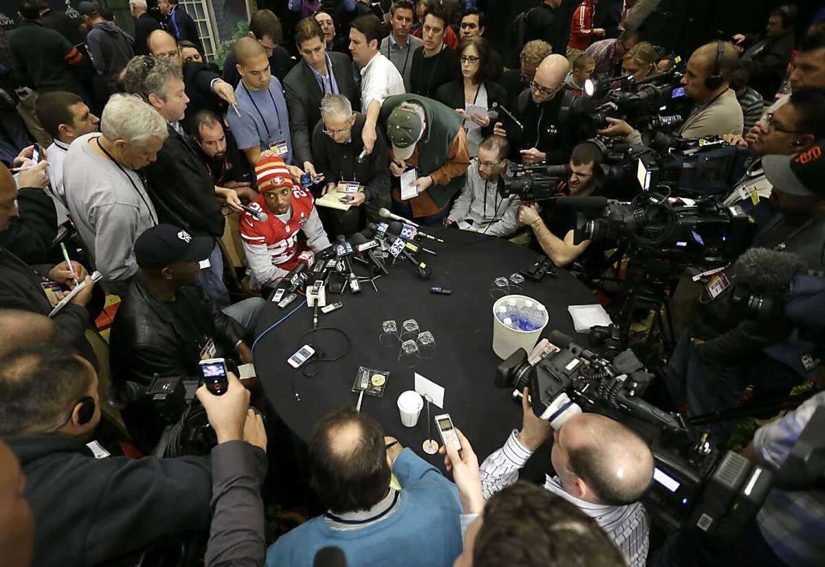 """San Francisco 49ers cornerback Chris Culliver, seated at top, answers questions Thursday, Jan. 31, 2013, in New Orleans, regarding anti-gay remarks he made during Super Bowl media day Tuesday. Culliver apologized for the comments he made to a comedian, saying """"that's not what I feel in my heart."""" The 49ers are scheduled to play the Baltimore Ravens in the NFL Super Bowl XLVII football game on Feb. 3. (AP Photo/Mark Humphrey)"""