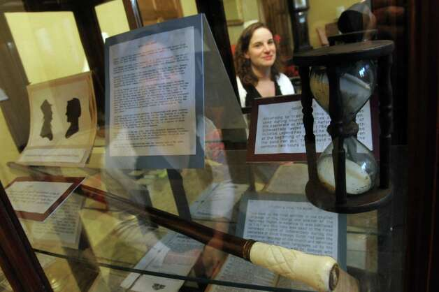 Caroline Welch seen in reflection through a artifact case at the First Reformed Church on Thursday Jan. 31,2013 in Schenectady, N.Y. (Michael P. Farrell/Times Union) Photo: Michael P. Farrell