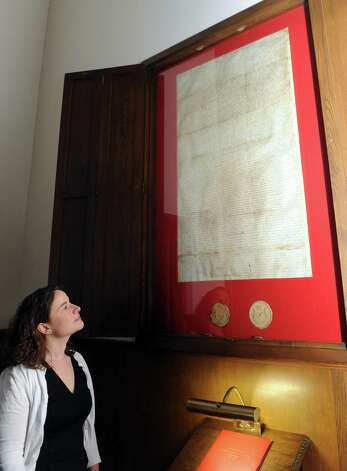 Caroline Welch stands in front of the church charter at the First Reformed Church on Thursday Jan. 31,2013 in Schenectady, N.Y. (Michael P. Farrell/Times Union) Photo: Michael P. Farrell