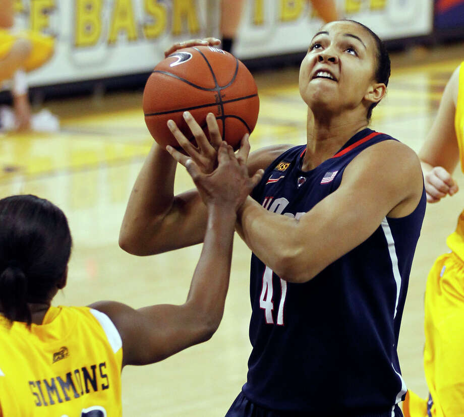Connecticut's Kiah Stokes(41) shoots against Marquette's Sarina Simmons, left, in the first half of an NCAA college basketball game, Saturday, Feb. 25, 2012, in Milwaukee. (AP Photo/Jeffrey Phelps) Photo: JEFFREY PHELPS, Associated Press / FR59249 AP