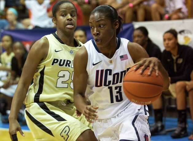 Connecticut guard Brianna Banks, right, dribbles past Purdue guard April Wilson during an NCAA women's college basketball game in St. Thomas, U.S. Virgin Islands, Saturday, Nov. 24, 2012. Connecticut won 91-57. (AP Photo/Thomas Layer) Photo: Thomas Layer, Associated Press / AP