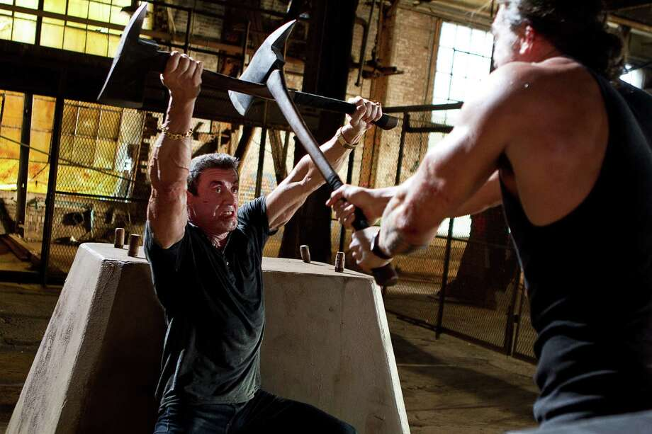 "This film image released by Warner Bros. Pictures shows Sylvester Stallone, left, and Jason Momoa in a scene from ""Bullet to the Head."" (AP Photo/Warner Bros. Pictures, Frank Masi) Photo: AP, HOEP / Warner Bros. Pictures"