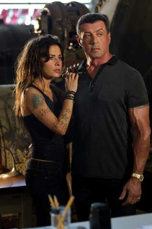"This film image released by Warner Bros. Pictures shows Sarah Shahi, left, and Sylvester Stallone in a scene from ""Bullet to the Head."" (AP Photo/Warner Bros. Pictures, Frank Masi) Photo: AP, HOEP / Warner Bros. Pictures"