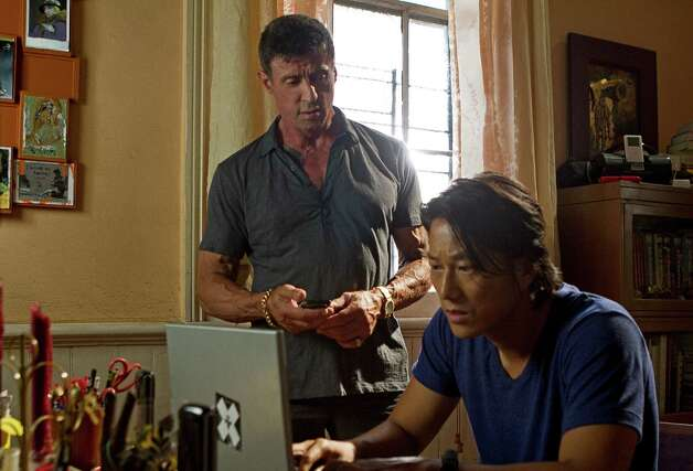 "This film image released by Warner Bros. Pictures shows Sylvester Stallone, left, and Sung Kang in a scene from ""Bullet to the Head."" (AP Photo/Warner Bros. Pictures, Frank Masi) Photo: AP, HOEP / Warner Bros. Pictures"