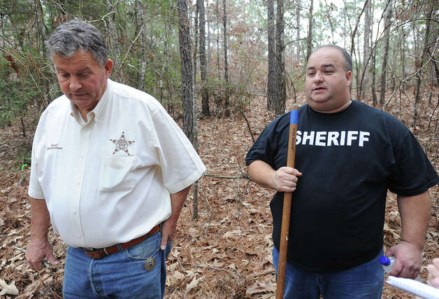 Mitchell Newman Jasper County Sheriff, left, and his staff searched an area north of Jasper Thursday for possible human remains after a man's skull was discovered on Tuesday. Several bones were found Thursday greatly increasing the size of the search area. It is undetermined if the newly found bones are of human or animal origin.   Photo taken Thursday, January 23, 2013 Guiseppe Barranco/The Enterprise Photo: Guiseppe Barranco, STAFF PHOTOGRAPHER / The Beaumont Enterprise