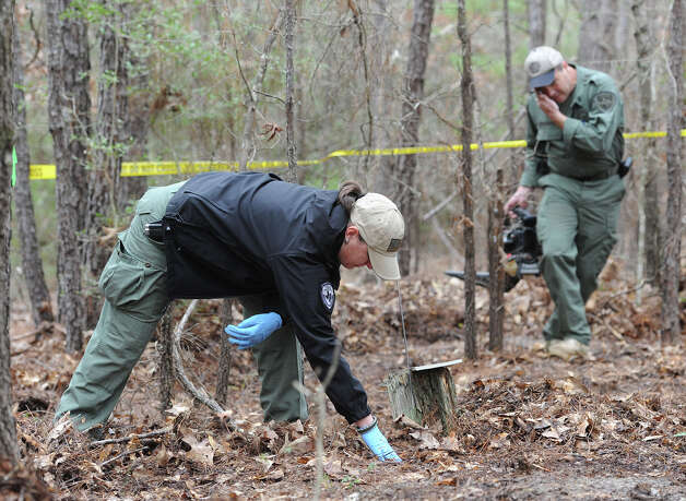 Wende Wakeman Texas Ranger searches for bones Thursday in an area north of Jasper were a man's skull was found on Tuesday. Rangers and Jasper Deputies have been combing the area finding several more bones. It is undetermined if the newly found bones are human or animal. Photo taken Thursday, January 23, 2013 Guiseppe Barranco/The Enterprise Photo: Guiseppe Barranco, STAFF PHOTOGRAPHER / The Beaumont Enterprise
