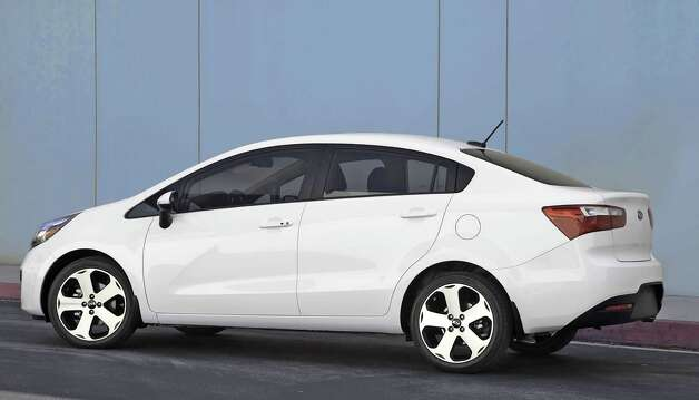 The Rio is KiaÕs entry-level model, one of the lowest-priced sedans sold in America with a base price of $13,600. The Rio handles the road well while offering a smooth and quiet ride and plenty of room. The interior is simple and uncluttered, yet well-done and attractive. Photo: Mike Ditz, Kia Motors America Inc. / ©2011MikeDitz (310)994-0307
