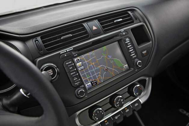 The 2013 Kia Rio offers a user-friendly navigation system with precise audible instructions and detailed turn-by-turn that is shown on its screen. The screen also displays audio system information and programming. Photo: Mike Ditz, Kia Motors America Inc. / ©2011MikeDitz (310)994-0307