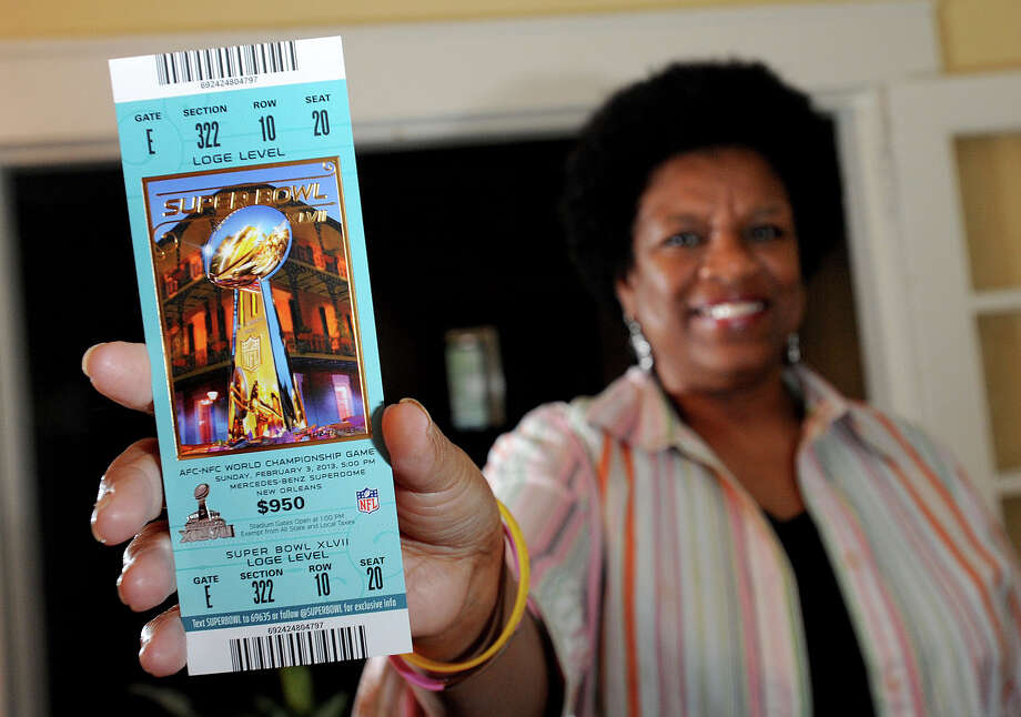 Due to an unfortunate mishap at the 2011 Super Bowl, Laverne 'Scooby' Jones of Beaumont received a free ticket from the NFL to attend today's Super Bowl in New Orleans. Jones was given the ticket after she and other fans at the Dallas Super Bowl were made to wait in line for three hours before the game. Jones received the ticket in early January. Photo taken Thursday, January 30, 2013 Guiseppe Barranco/The Enterprise Photo: Guiseppe Barranco, STAFF PHOTOGRAPHER / The Beaumont Enterprise