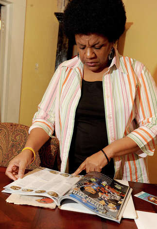 Laverne 'Scooby' Jones of Beaumont looks through the program she bought at the 2011 Super Bowl in Dallas. Jones will be attending today's Super Bowl in New Orleans thanks to a free ticket from the NFL. Photo taken Thursday, January 30, 2013 Guiseppe Barranco/The Enterprise Photo: Guiseppe Barranco, STAFF PHOTOGRAPHER / The Beaumont Enterprise