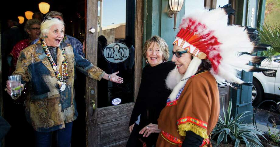 Elise Stevens, left, of Galveston, screams in appreciation of Jeri Kinnear's, of Galveston, costume before a Mardi Gras Procession at the M&M bar and grill Friday, Feb. 1, 2013, in Galveston. Photo: Nick De La Torre, Chronicle / © 2010 Houston Chronicle
