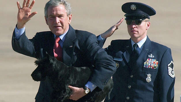 President George W. Bush is pictured with one of the family's Scottish