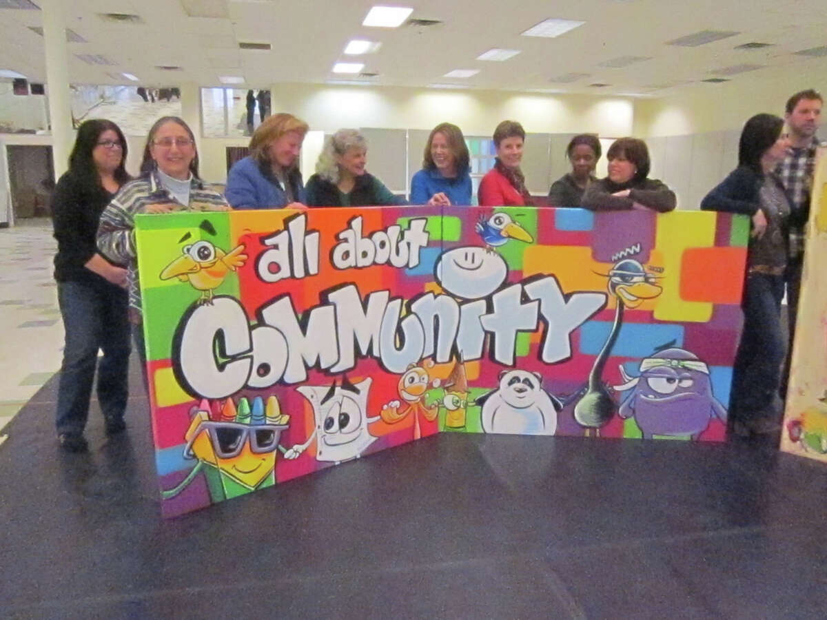 """This """"All About Community"""" mural is by Yedi Fresh. It goes on display at the opening of the HealingNewtown Art Space on Valentine's Day, Feb. 14."""