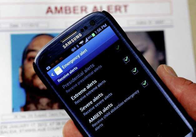 In this Thursday,  Jan. 31, 2013, photo, an Amber Alert app is seen on the cell phone of Capt. Greg Gerrero of the California Highway Patrol in Sacramento, Calif. A new national Amber Alert system will automatically send alerts to millions of cell phones when an alert is issued in their area. The alerts are automatically active on most new phones and users will have to opt out if they do not wish to receive them.  Photo: Rich Pedroncelli, Associated Press / AP