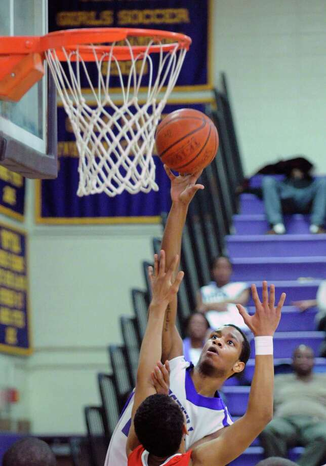 Westhill's Ariel DelaCruz scores over CJ Byrd of Greenwich during the boys high school basketball game between Westhill High School and Greenwich High School at Westhill in Stamford, Friday night, Feb. 1, 2013. Photo: Bob Luckey / Greenwich Time