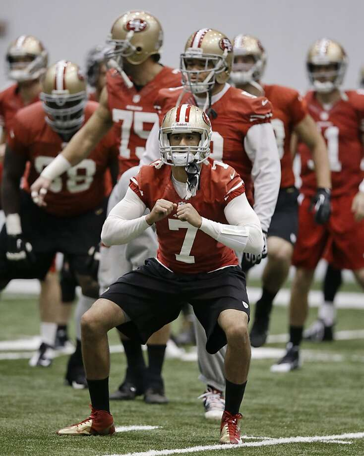 Colin Kaepernick stretches during an indoor practice at the Saints' facility in Metairie, La. A walk-through Saturday will be the last preparation before the Super Bowl. Photo: Mark Humphrey, Associated Press