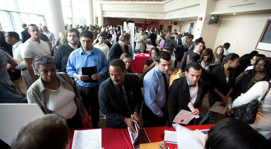 In this Tuesday, Jan. 22, 2013 photo, job seekers fill a room at the job fair in Sunrise, Fla. U.S. employers added 157,000 jobs in January, and hiring was much stronger at the end of 2012 than previously thought, providing reassurance that the job market held steady even as economic growth stalled, according to Labor Department reports, Friday, Feb. 1, 2013. (AP Photo/J Pat Carter) Photo: J Pat Carter