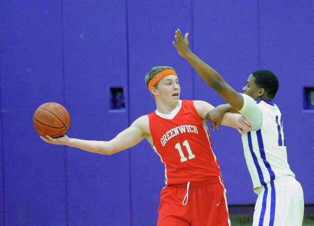 At left, Alex McMurray # 11 of Greenwich looks to pass while being covered by Guyveson Cassamajor of Westhill during the boys high school basketball game between Westhill High School and Greenwich High School at Westhill in Stamford, Friday night, Feb. 1, 2013. Photo: Bob Luckey / Greenwich Time