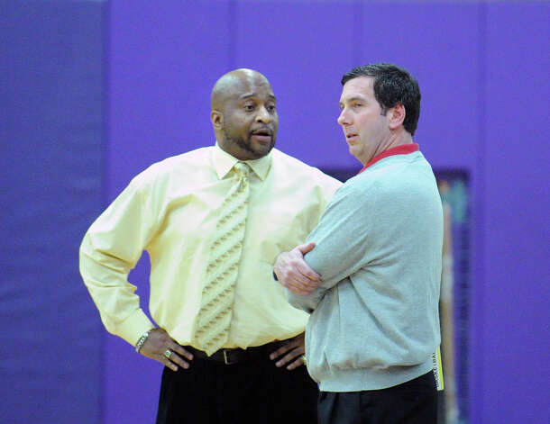 At left, Westhill basketball coach Howard White converses with Greenwich basketball coach Bill Brehm before the start of the boys high school basketball game between Westhill High School and Greenwich High School at Westhill in Stamford, Friday night, Feb. 1, 2013. Photo: Bob Luckey / Greenwich Time