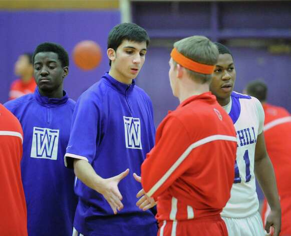 Westhill's Evan Skoparantzos, left, shkaes hands with Alex McMurray of Greenwich before the start of the boys high school basketball game between Westhill High School and Greenwich High School at Westhill in Stamford, Friday night, Feb. 1, 2013. Photo: Bob Luckey / Greenwich Time